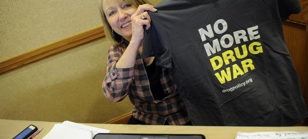 DENVER, CO - OCTOBER 23 : International Drug Policy Reform Conference  is being held in Denver, October 23-26 at the Sheraton Denver Downtown Hotel. Conference coordinator Kay Burke shows off the Reform  t-shirt on Wednesday, October 23, 2013 as booths were being set up.   (Photo By Cyrus McCrimmon/The Denver Post  )